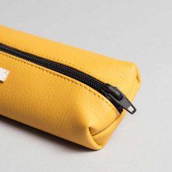 Vegan leather pencil case in mustard (detail)