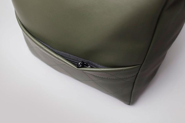 Vegan leather backpack in olive green (detail of the pocket)