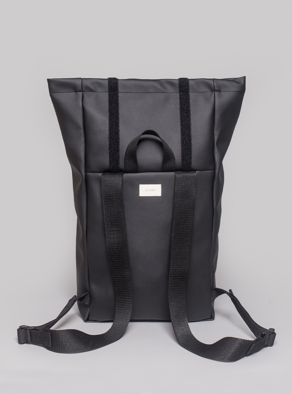 Roll–top backpack (black) in vegan leather, made in Portugal by wetheknot.