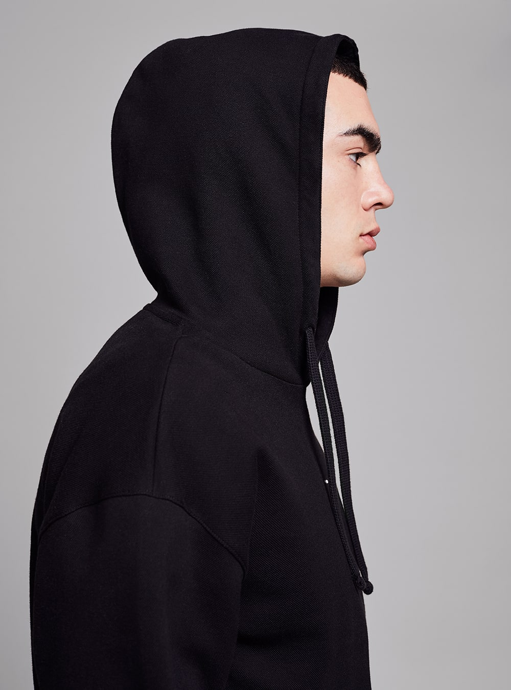 Piqué hoodie (black) in organic cotton, made in Portugal by wetheknot.